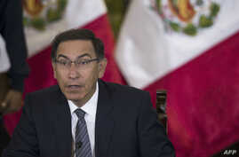 Peruvian President Martin Vizcarra gestures as he speaks, during a press conference with representatives of foreign media in Lima, June 5, 2018.
