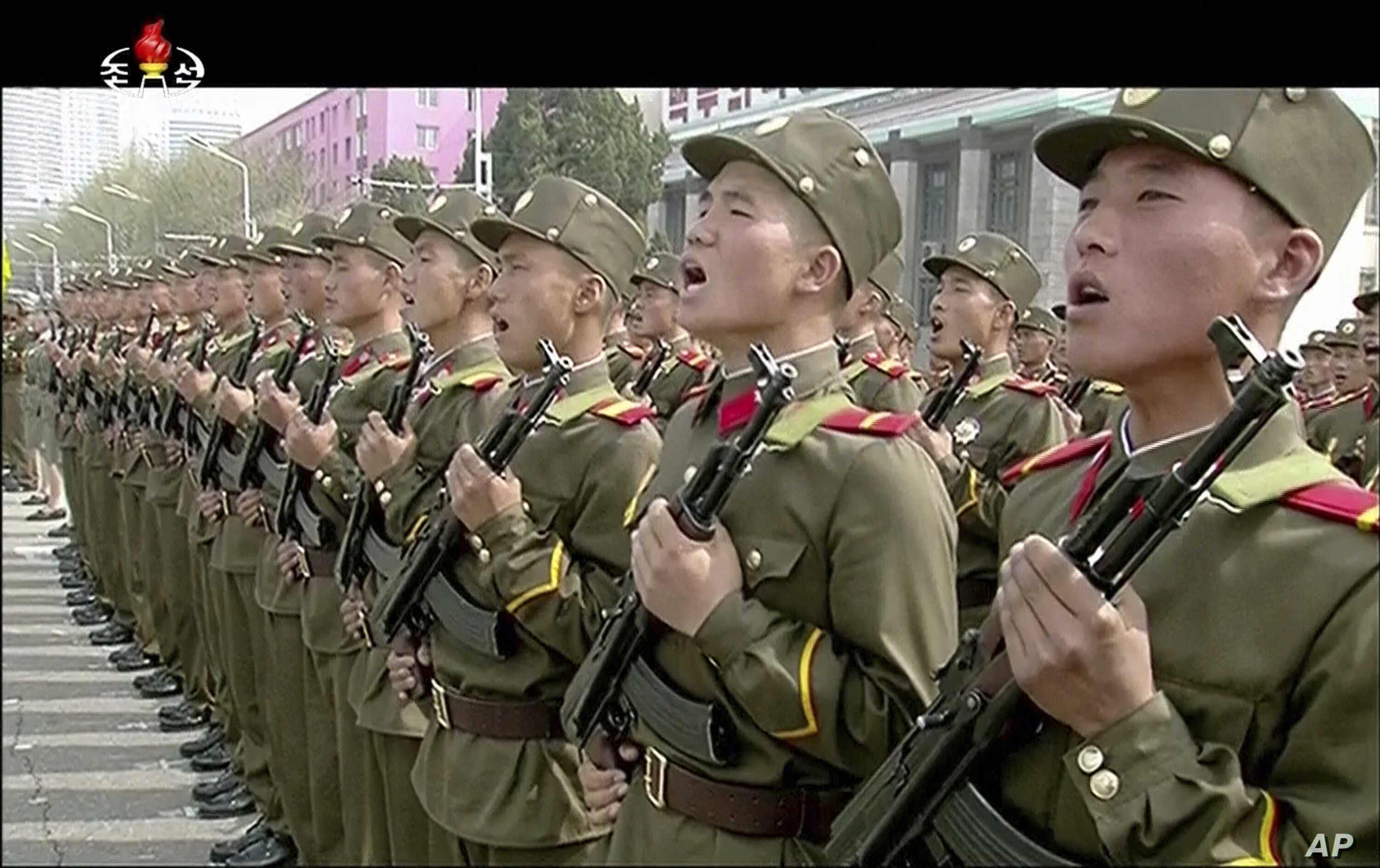 In this image made from video broadcast by North Korean broadcaster KRT, soldiers take part in a parade at Kim Il Sung Square in Pyongyang, April 15, 2017. North Korean leader Kim Jong Un has appeared in a massive parade in the capital, Pyongyang, ce
