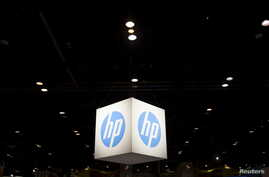 FILE - The Hewlett-Packard (HP) logo is seen as part of a display at the Microsoft Ignite technology conference in Chicago, Illinois, May 4, 2015.