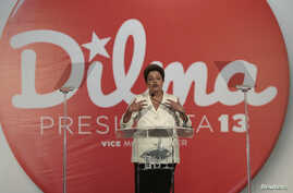 Brazil's President and Workers' Party (PT) presidential candidate Dilma Rousseff holds a news conference after voting in the first round of election in Brasilia, Oct. 5, 2014.