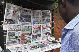 Newspapers with various front page headlines on the Chibok girls and their possible release are displayed at a news stand in Abuja, Oct. 18, 2014.
