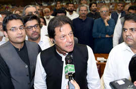 In this photo released by the National Assembly, the leader of Pakistan Tahreek-e-Insaf party Imran Khan,speaks at the National Assembly in Islamabad, Pakistan, Aug. 17, 2018. Pakistani lawmakers Friday elected former cricket star and longtime politi