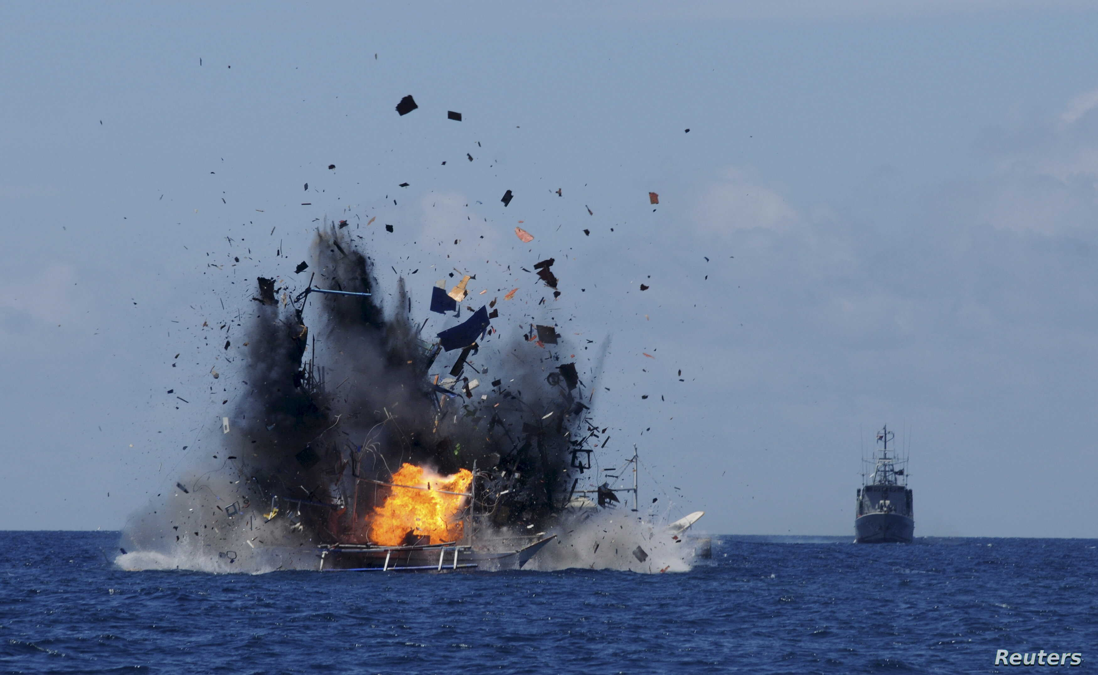 The Indonesian navy scuttles foreign fishing vessels caught fishing illegally in Indonesian waters near Bitung, North Sulawesi May 20, 2015 in the is photo taken by Antara Foto.