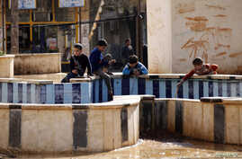 FILE - Children play in the town of Azaz, near the Syrian-Turkish border, March 2014. Syrian refugees in this border outpost were delighted to hear their home town of Azaz had been liberated from al-Qaida fighters who subjected them to a regime that