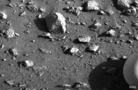 First image taken by Viking 1 on July 20, 1976 to show that the lander was upright with its foot planted firmly on the Martian soil.