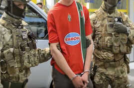 In this image, provided by the Ukrainian Intelligence Agency SBU on Monday, June 6, 2016, SBU agents detain a suspect at the Yahodyn border crossing on the Ukrainian-Polish border, Ukraine.