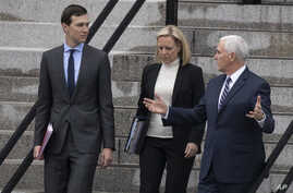 White House senior adviser Jared Kushner, Homeland Security Secretary Kirstjen Nielsen and Vice President Mike Pence talk as they walk down the steps of the Eisenhower Executive Office Building on the White House complex, Jan. 5, 2019, in Washington....