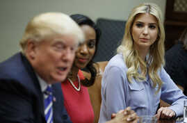Ivanka Trump, daughter of President Donald Trump, right, and Jessica Johnson, center look to President Trump as he speaks during a meeting with women small business owners in the Roosevelt Room of the White House, in Washington,  March 27, 2017.