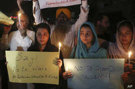 Pakistani civil society activists protest against the recent attacks in Kabul, Afghanistan, which killed many people, in Peshawar, Pakistan, June 3, 2017.