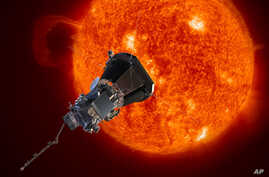 This image made available by the Johns Hopkins University Applied Physics Laboratory on Wednesday, May 31, 2017 depicts NASA's Solar Probe Plus spacecraft approaching the sun.