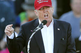 FILE - Republican presidential candidate Donald Trump speaks during a rally in Madison, Ala., Feb. 28, 2016. The Republican =front-runner has staked out uncompromising positions on Asia policy that could strain U.S. relations with the region if he wi