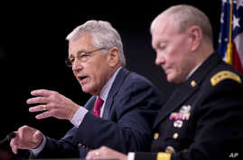 U.S. Defense Secretary Chuck Hagel, left, and Joint Chiefs Chairman Gen. Martin Dempsey brief reporters at the Pentagon July 3, 2014.