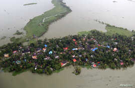 An aerial view shows partially submerged houses at a flooded area in the southern state of Kerala, Aug. 19, 2018.
