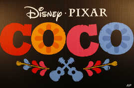 "The =logo at the premiere of Disney Pixar's ""Coco"" at Le Grand Rex in Paris, Nov. 14, 2017."