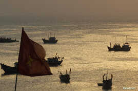 Fishing boats are seen on bay of Ly Son islands of Vietnam's central Quang Ngai province April 10, 2012.