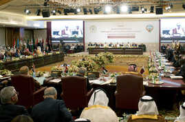 Kuwait's FM Sheikh Sabah al Khaild al Sabah (C) hosts the preparatory meeting of Arab Foreign Ministers in Kuwait City March 23, 2014, ahead of 25th Arab League Summit which will take place in Kuwait March 25.