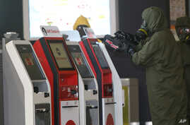 A hazmat crew scana the check-in kiosk machines at Kuala Lumpur International Airport 2 in Sepang, Malaysia,Feb. 26, 2017. Malaysian police ordered a sweep of Kuala Lumpur airport for toxic chemicals and other hazardous substances following the killi