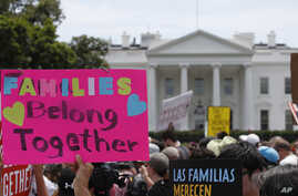 FILE - In this June 20, 2018, file photo, activists march past the White House to protest the Trump administration's approach to illegal border crossings and separation of children from immigrant parents in Washington.