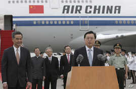 The chairman of the Standing Committee of China's National People's Congress, Zhang Dejiang (R) speaks to the media next to Hong Kong's Chief Executive CY Leung (L) after arriving at Hong Kong's airport, May 17, 2016. Authorities rolled out a massive