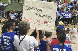 Protesters gather outside the state Capitol building, April 14, 2017, in Little Rock, Ark., to voice their opposition to Arkansas' seven upcoming executions.