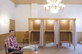 An election official waits in a polling station in Stoessen, Germany, March 13, 2016. Federal state elections will be held in Baden-Wuerttemberg, Rhineland-Palatinate and Saxony-Anhalt on Sunday.