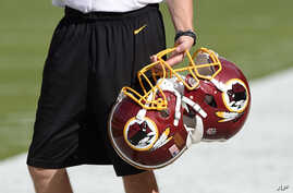 FILE - Washington Redskins football helmets are seen before a game in Landover, Md., Aug. 19, 2016. The Supreme Court could decide to hear a case this term centering on whether trademarks deemed offensive to some can be canceled.