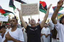 Supporters of Operation Dawn, a group of Islamist-leaning forces mainly from Misrata, demonstrate against the Libyan parliament, Tripoli, Aug. 29, 2014.