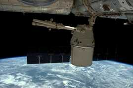 This photo released by NASA shows the SpaceX Dragon undocked from the International Space Station as it is maneuvered for its release May 11, 2016.