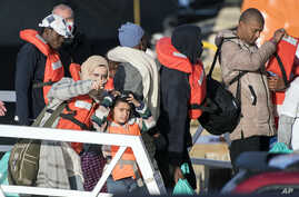 Migrants disembark at Hay Wharf, Pieta, Malta, Jan. 9, 2019. The 49 rescued migrants who were stranded at sea since last month were brought to Malta and then distributed among eight European Union countries. Both Italy and Malta have refused to let p