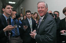 House Freedom Caucus Chairman Rep. Mark Meadows, R-N.C. smiles as he speaks with the media on Capitol Hill in Washington, March 23, 2017.