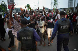 Residents celebrate in Kinshasa, Jan. 10, 2019, after learning that opposition presidential candidate Felix Tshisekedi has been declared the winner of the elections.