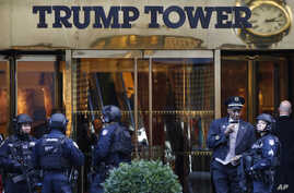 FILE - Members of the New York Police Department's counterterrorism unit guard Trump Tower, in New York City, Nov. 14, 2016.