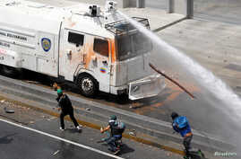 A police water cannon disperses demonstrators during an opposition rally in Caracas, Venezuela, April 6, 2017.