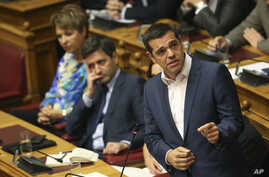 Greek Prime Minister Alexis Tsipras speaks during a parliamentary session in Athens, June 14, 2018.