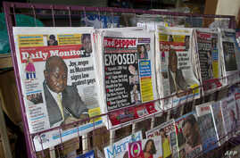 A newspaper stand displays Uganda's local dailies with headlines a day after President Yoweri Museveni signed a bill into law which holds that repeat homosexuals should be jailed for life, outlaws the promotion of homosexuality and requires people to