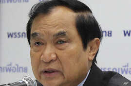 FILE- former Thai Interior Minister and former leader of Pheu Thai Party Charupong Reuangsuwan speaks at a news conference.