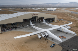 """The """"Roc"""" plane is seen outside its hangar. (Stratolaunch)"""
