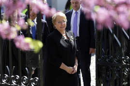 Chile's President Michelle Bachelet, followed by her Portuguese counterpart Marcelo Rebelo de Sousa, background left, enters the University of Evora to receive an honorary doctorate from the university in Evora, Portugal, March 30 2017.