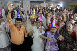 Global Aging: Elderly Indians participate in celebrations to mark International Day of Older Persons at an old age home in Ahmadabad, India, Tuesday, Oct. 1, 2013.