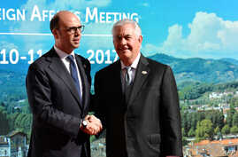 Italy's Foreign Minister Angelino Alfano (L) welcomes US Secretary of State Rex Tillerson  as he arrives for a meeting of Foreign Affairs Ministers from the Group of Seven (G7) industrialised countries on April 10, 2017 in Lucca, Tuscany. Italy's For