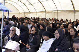 Ethiopians and family members of the Ethiopian airlines crash victims hold the 40th day remembrance, as per Ethiopian tradition, in Bishoftu, Ethiopia, Apr. 18, 2019.