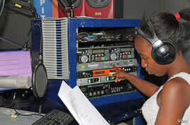 Florence Mwale a host of Business Today show at Capita Radio presses profanity delay system that can block obscene and offensive language.