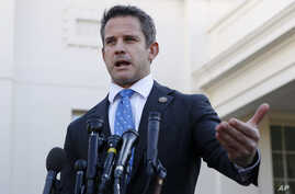 FILE - Rep. Adam Kinzinger, R-Ill., speaks to the media, at the White House in Washington.