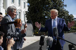 President Donald Trump talks to reporters on the South Lawn of the White House, Friday, Oct. 4, 2019, in Washington. (AP Photo…
