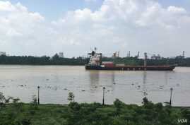 A container ship moves along the Saigon River, used to ship the kinds of exports that have increased Vietnam's role in global trade.