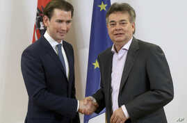 Sebastian Kurz, left, head of the Austrian People's Party, OEVP, shakes hands with Werner Kogler, right, head of the Austrian Greens during a press conference after finishing the coalition negotiations in Vienna, Austria, Jan. 1, 2020.