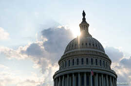 FILE PHOTO: The dome of the U.S. Capitol Building is seen as the sun sets on Capitol Hill in Washington, U.S.,  July 26, 2019…