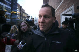Harvard University professor Charles Lieber is surrounded by reporters as he leaves the Moakley Federal Courthouse in Boston,…