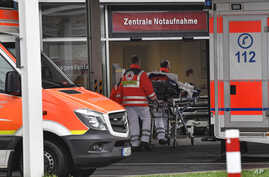 Paramedics work at the University Hospital in Duesseldorf, Germany, where a man who tested positive for the coronavirus is being treated, Feb. 26, 2020.