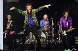 FILE - From left, Ron Wood, Mick Jagger, Charlie Watts and Keith Richards of the Rolling Stones perform in Pasadena, California, Aug. 22, 2019.